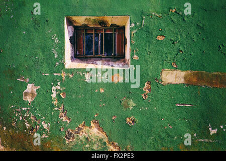 Broken window on old vintage wall from abandoned house - Stock Photo