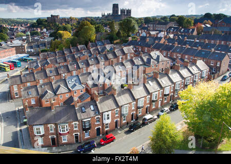 A view from above looking down onto rows of tightly packed terraced houses on the city streets of Durham, UK. - Stock Photo