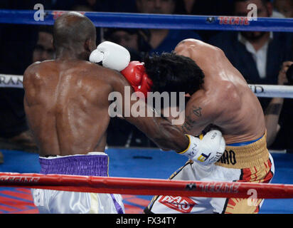 Las Vegas NV, USA. 9th Apr, 2016. (in Wht/Yell tnks) Manny Pacquiao goes 12 rounds with Timothy Bradley Saturday at the MGM Grand Garden hotel. Manny Pacquiao took the win by unanimous decision for the international welterweight championship.Photo by Gene Blevins/LA Daily News/ZumaPress © Gene Blevins/ZUMA Wire/Alamy Live News Stock Photo