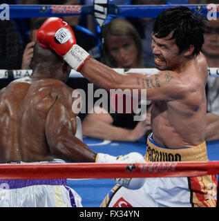 Las Vegas NV, USA. 9th Apr, 2016. (in Wht/Yell tnks) Manny Pacquiao goes 12 rounds with Timothy Bradley Saturday - Stock Photo