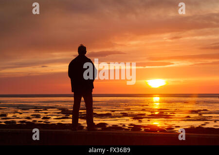 Southport, Merseyside, UK. 10th April, 2016. UK Weather. Sunset over the Irish Sea as seen from Southport seafront - Stock Photo