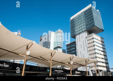 Asymmetrical CZF Office Block, along Passeig Del Taulat street with canopy of Diagonal Mar Shopping Centre,Barcelona,Spain. - Stock Photo