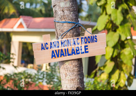 Closeup to a sign in India advertising Air Conditioned and Non Air Conditioned Rooms in India - Stock Photo