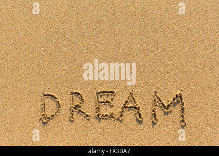 Dream - drawn of the hand on the beach sand. - Stock Photo