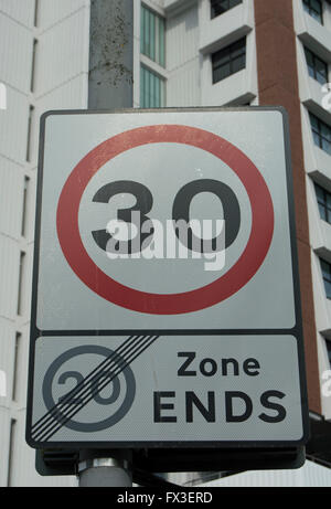 british road sign making the end of a 20mph speed limit zone and the start of a 30mph speed limit