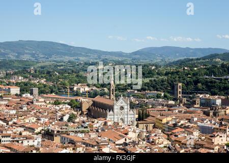 Florence, Italy cityscape showing the surrounding hills and the ornate marble facade of Santa Croce Church.  Copy - Stock Photo