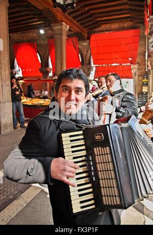 Street musician in  Mercato di Rialto, the traditional market close to the famous bridge, Sestiere di San Polo, - Stock Photo