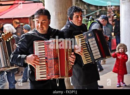 Street musicians in  Mercato di Rialto, the traditional market close to the famous bridge, Sestiere di San Polo, - Stock Photo