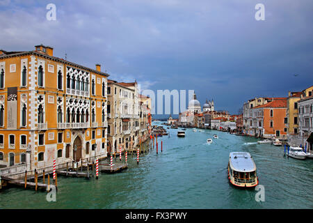 View of the Grand Canal from Ponte dell'Accademia, Venice, Italy.  In the background, Santa Maria della Salute. - Stock Photo