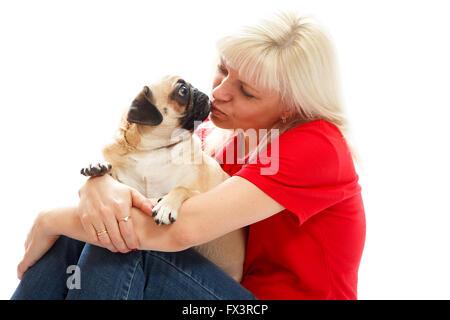 oman kissing a pug - Stock Photo