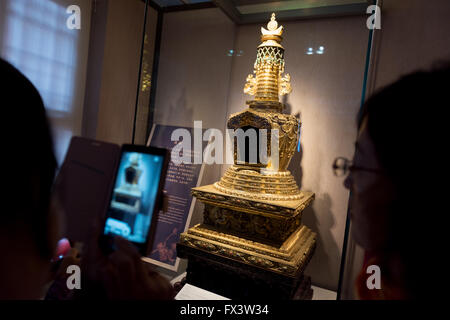 Beijing, China - October 25, 2015: Visitor taking picture of a Gold Stupa in the Palace Museum in the Forbidden - Stock Photo
