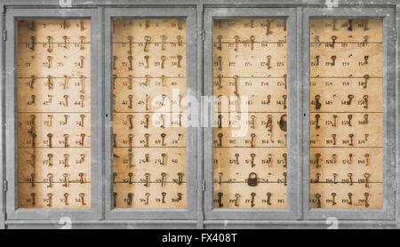 Vintage keys with numbers hanging in an old closet - Stock Photo