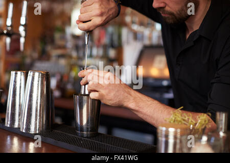 Close Up Of Barman Mixing Cocktail On Counter - Stock Photo