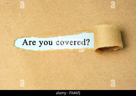 Are you covered? word written under torn brown paper. - Stock Photo