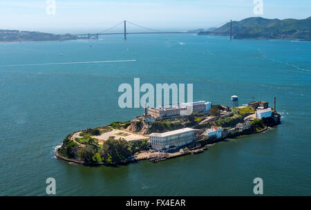 Aerial view, Alcatraz, Golden Gate Bridge in the background, Alcatraz Iceland with lighthouse in backlight, San - Stock Photo
