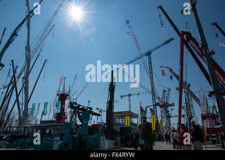 Munich, Germany. 11th Apr, 2016. Cranes in various configurations and heights can be seen at the opening of Bauma, - Stock Photo