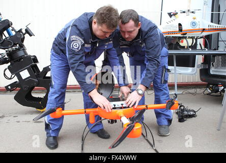 ST. PETERSBURG, RUSSIA. APRIL 6, 2016. Rosatom Emergency Service workers launching a drone, Granad VA-1000. The - Stock Photo