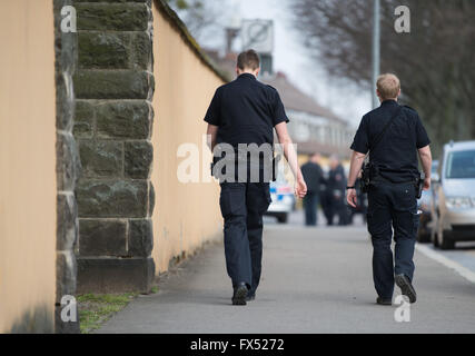 Hanover, Germany. 11th Apr, 2016. Two policemen walking along a street in Hanover, Germany, 11 April 2016. PHOTO: - Stock Photo