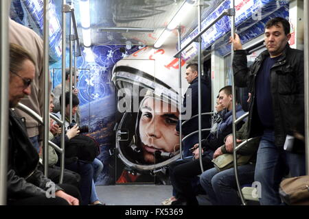 Moscow, Russia. 12th Apr, 2016. Commuters in a space themed train at Polezhayevskaya station of the Moscow Metro. - Stock Photo