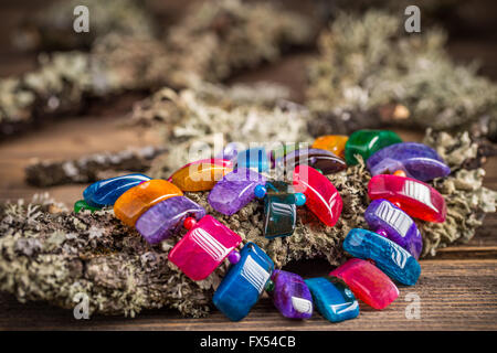 Necklace made of colorful semi precious stones - Stock Photo