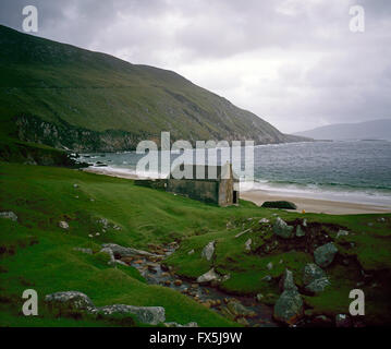 Deserted cottage on Keem Strand, Achill Island, County Mayo, West Coast of Ireland - Stock Photo