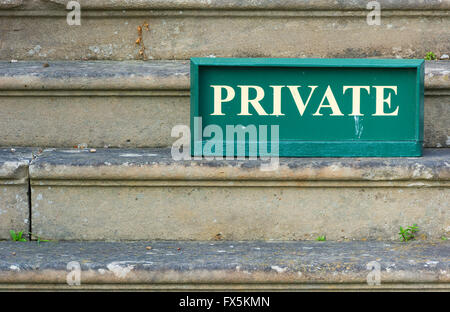 Old Private sign standing on weathered stone steps - Stock Photo