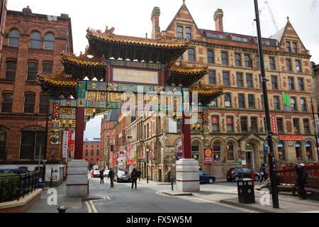 China town, Manchester, Uk with large ornate painted archway at the entrance. - Stock Photo