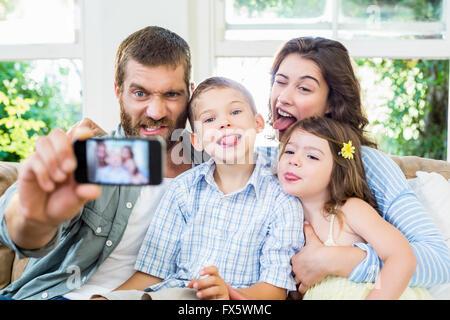 Happy family taking a selfie - Stock Photo