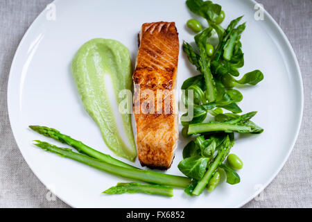 Salmon, lamb lettuce, asparagus and soy beans - Stock Photo