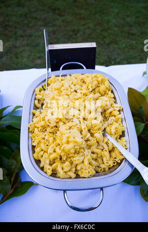 Buffet dinner at a wedding reception includes gluten free pasta for guests with food allergies. - Stock Photo