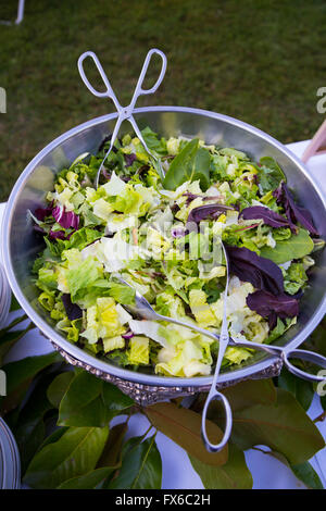 Buffet dinner at a wedding reception includes a nice healthy salad. - Stock Photo