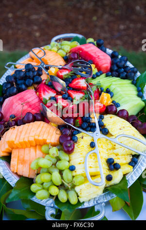Buffet dinner at a wedding reception includes this mixed fruit plate. - Stock Photo