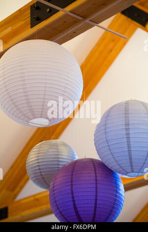 Chinese Of Japanese Paper Lanterns Hang From Wood Rafters At A Stock