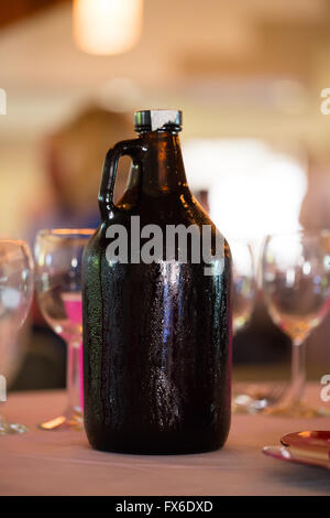 Growler full of craft beer at a wedding reception. - Stock Photo