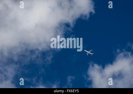 A passenger aircraft in the sky over the UK. - Stock Photo