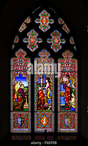Stained glass window in St Gile's Church at Calke Abbey, near Ticknall, Derbyshire, England, UK - Stock Photo