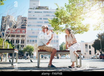 Senior man taking photos of his woman. Mature couple having fun on their holiday. - Stock Photo