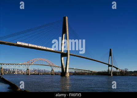 Bridges over Fraser River, New Westminster to Surrey, British Columbia, Canada - Skytrain on SkyBridge, Pattullo - Stock Photo