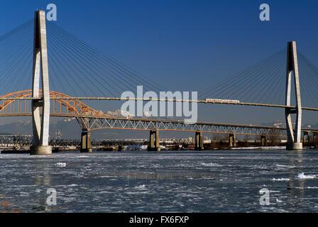 Bridges over Fraser River, New Westminster to Surrey, British Columbia, Canada - Skytrain on SkyBridge, Pattullo - Stock Photo