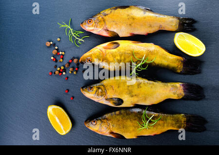 Grilled gilthead bream with fresh rosemary herb lemon and for Aromatic herb for fish