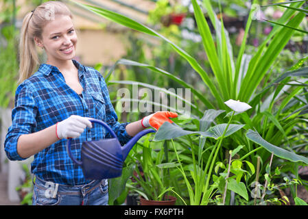 portrait of a young beautiful female gardener - Stock Photo