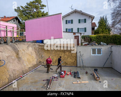 Prefabricated house workers in setting up the basement for Prefabricated basement walls