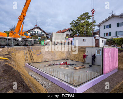 Construction Workers Building A Prefabricated House In A