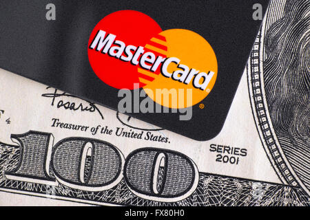 Tambov, Russian Federation - April 02, 2016 Mastercard logo on credit card and 100 dollar bill. Studio shot. - Stock Photo