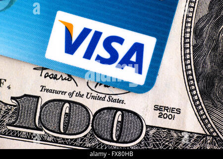 Tambov, Russian Federation - April 02, 2016 Visa logo on credit card and 100 dollar bill. Studio shot. - Stock Photo