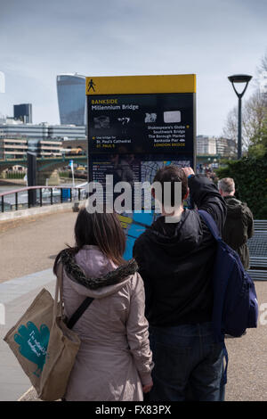 Millennium bridge sign on the South bank of the River Thames - Stock Photo