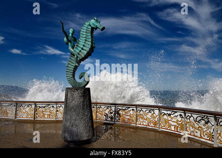 The Boy on a Seahorse sculpture Puerto Vallarta Malecon with splash of Pacific ocean water Mexico - Stock Photo