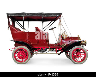 Red 1908 McLaughlin-Buick Model F antique vintage retro car side view isolated on white background with clipping - Stock Photo