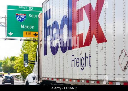 FedEx Freight truck on Atlanta, Georgia's I-285 headed south toward the I-675 exit. - Stock Photo