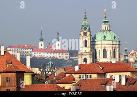 Prague, Czech Republic. St Nicholas Church (Kostel svatého Mikuláše - 1755, Baroque) in Mala strana, seen from across - Stock Photo